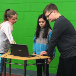 Students using green screen and WeVideo