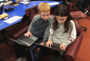students helping each other with WeVideo