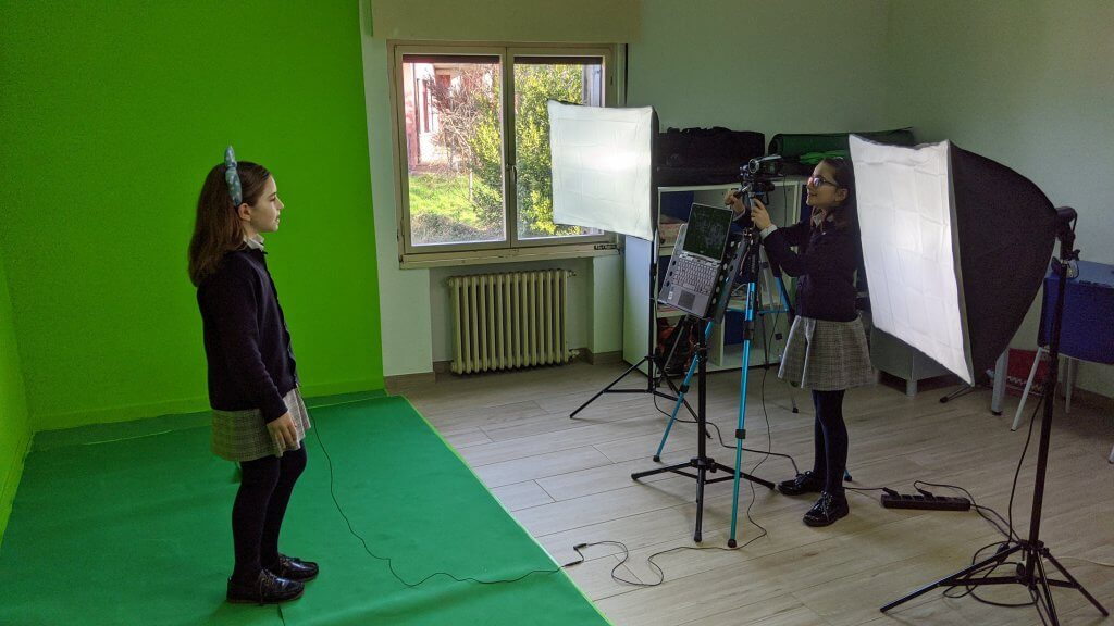 students in front of green screen